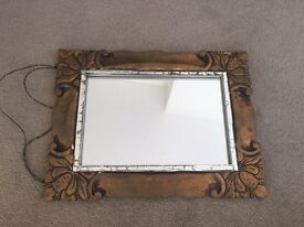 Small mirror with antique style wooden frame.