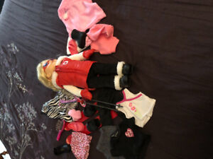 Doll with ski set and clothing