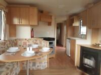 Perfect starter static caravan for sale located on the beach site fees £2495!!