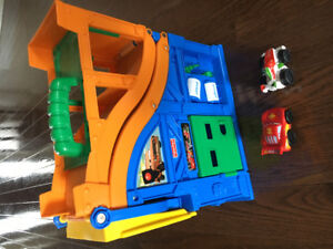 Fisher price car's race track with 2 cars