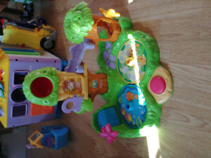 Fisher price roll-a-rounds and jungle friends treehouse