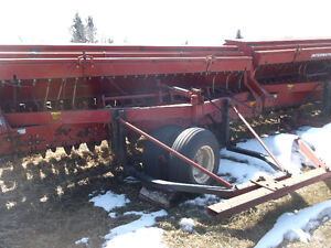 12 foot IH 6200 press drill with grass seed atchment