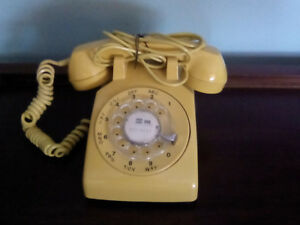 Yellow vintage dial phone