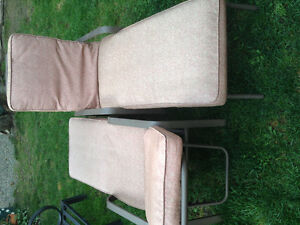 Reclining patio loungers with cushions