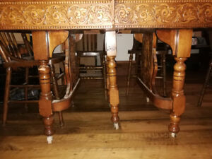 Antique dining  table with 6 chairs and 4 extra leaves.