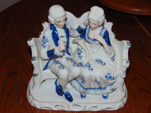 Man and woman porcelain figurine on settee