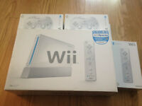 Brand new sealed Wii console +2 wii remotes +2 wii gamepads