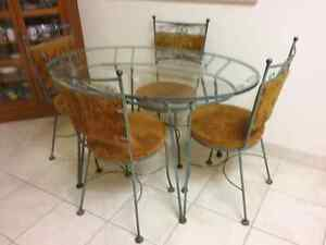 Oval glass table with 4 chairs