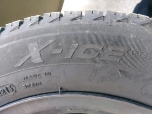 Four Michelin X-Ice winter tires 185/60R14 with new rims