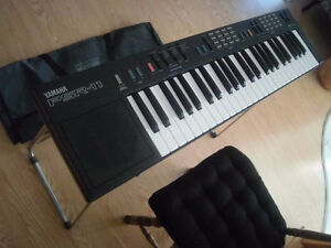 Yamaha PSR-11 Piano Keyboard with case/Stand/ foot pedal....