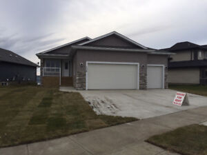 Beuatiful Brand New Bungalow Triple Heated Garage!!