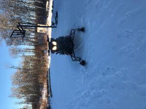 Kids snowmobie