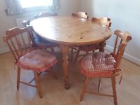 Solid pine extending dining room table and 6 chairs