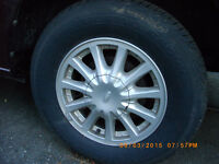 4x215/70R15 Ford Mag & Tires Like New
