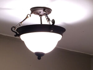 Many light fixtures and small shades for sale
