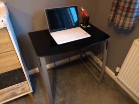 Desk, metal frame with black glass top. USB ports