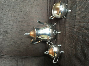 Silver plated, brass tea pot, sugar and cream dishes