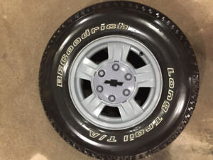 (4) 235/75/15 BFG Trail touring tires on Refurb Alum Wheels