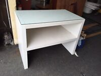 White glass topped display desk