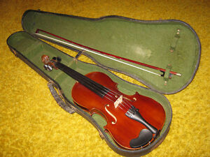 Vintage violin, case and bow.