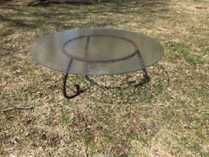 Glass table with cast iron base