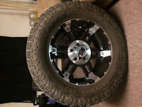 """35"""" Toyo Open Country with -12 offset 20"""" rims"""
