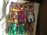 set of 7 never opened Ty beanie babies