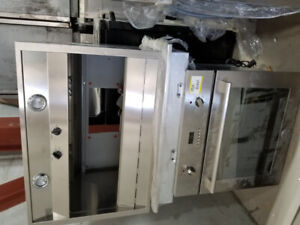 GE stainless range hood, and GE profile oven (industrial)kitchen
