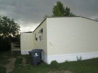 3 Mobile Home for Sale in Wilkie with Lot