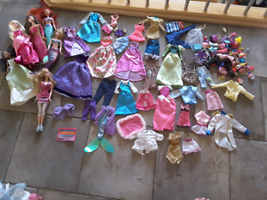 Lot of Barbies - includes accessories, clothes, and DVD!!!