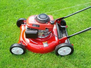 "HONDA POWERED 21"" DELUXE CRAFTSMAN LAWN MOWER $250."