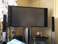 Tv with surround sound 2 speakers and DVD player for extra sound