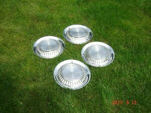1960 Pontiac Hubcaps Nice condition.
