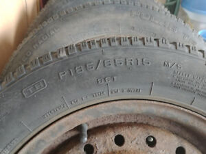 Set of 4 Hercules winter tires with Steel Rim. Great condition.