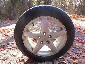 PIRELLI SNOW TIRES AND RIMS SET OF FOUR 205/55 R 16 (USED)