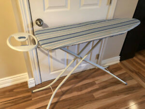 Adjustable Ironing board featuring an oval rest for your iron