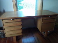 solid wood desk with lots of drawers
