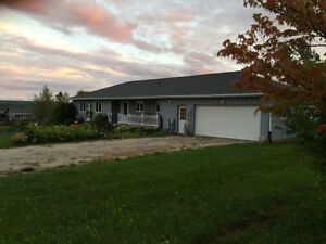 NEW PRICE!!  Spacious Country Bungalow with perennial gardens!