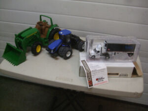 TWO ERTL TRACTORS AND TWO DIE CAST TRUCKS