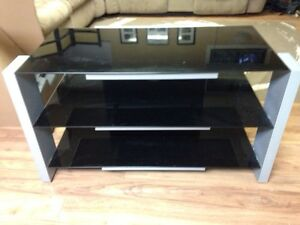 TV stand. Glass and metal.