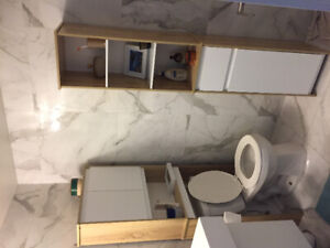 Over the toilet storage and matching washroom shelving unit.