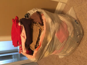 Tons of boy clothes by the bag full