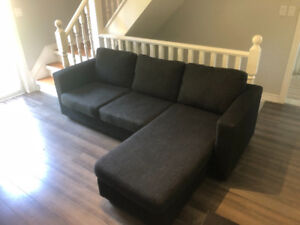 Couch with chaise lounge section & adjustable! Good Condition!