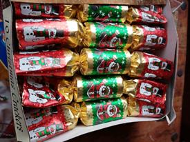 Christmas crackers. Purple bauble bundle. Gift bags. Tinsel. Santa ici