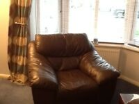 Two Brown Leather Chairs