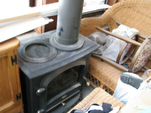 Electric fireplace...hardy used...heat and flame