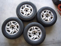 Four 215/70R15 Tires and alloy rims
