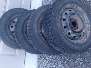4- WINTER TIRES & STEEL RIMS 175/ 65 14