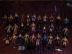 Wwe action figures plus a few accessories