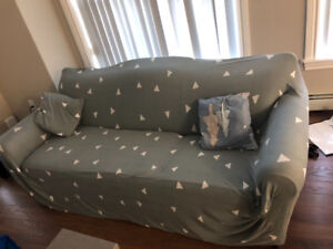Couch with covers and two pillows for 250